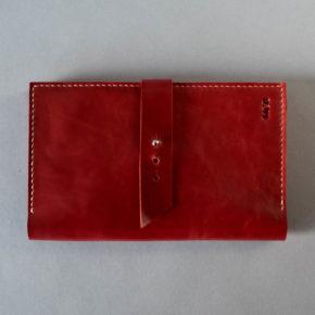 red leather passport holder