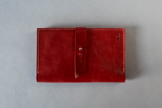 red leather passport holder