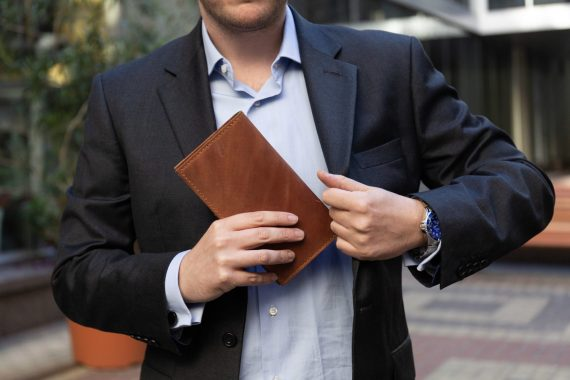 business man with long wallet