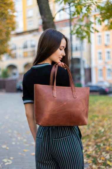 woman with leather tote
